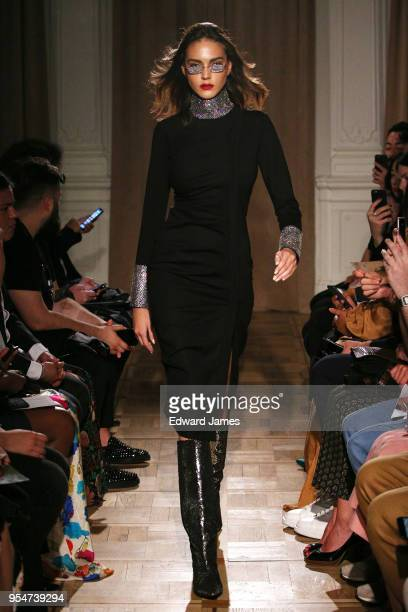 A model walks the runway during the Anouki Fall/Winter 2018/2019 Collection fashion show at MercedesBenz Fashion Week Tbilisi on May 4 2018 in...
