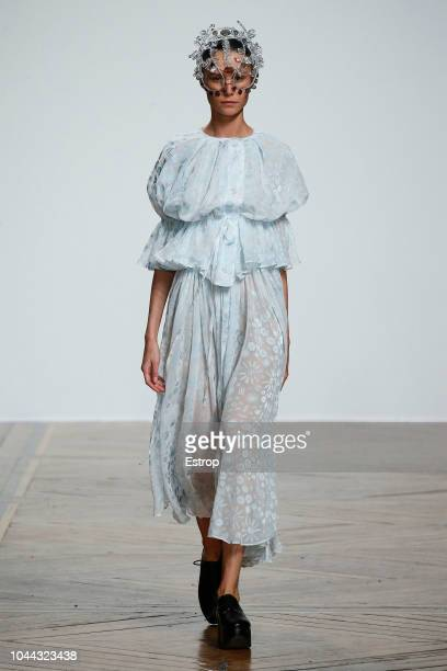 A model walks the runway during the Anrealage show as part of the Paris Fashion Week Womenswear Spring/Summer 2019 on September 25 2018 in Paris...