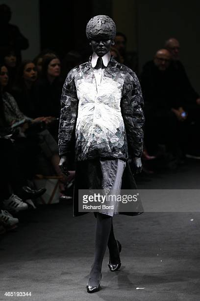 A model walks the runway during the Anrealage show as part of the Paris Fashion Week Womenswear Fall/Winter 2015/2016 at Palais des Beaux Arts on...