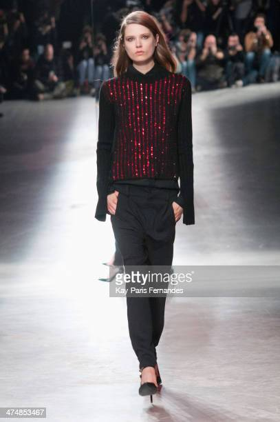 Model walks the runway during the Anthony Vaccarello show as part of the Paris Fashion Week Womenswear Fall/Winter 2014-2015 on February 25, 2014 in...