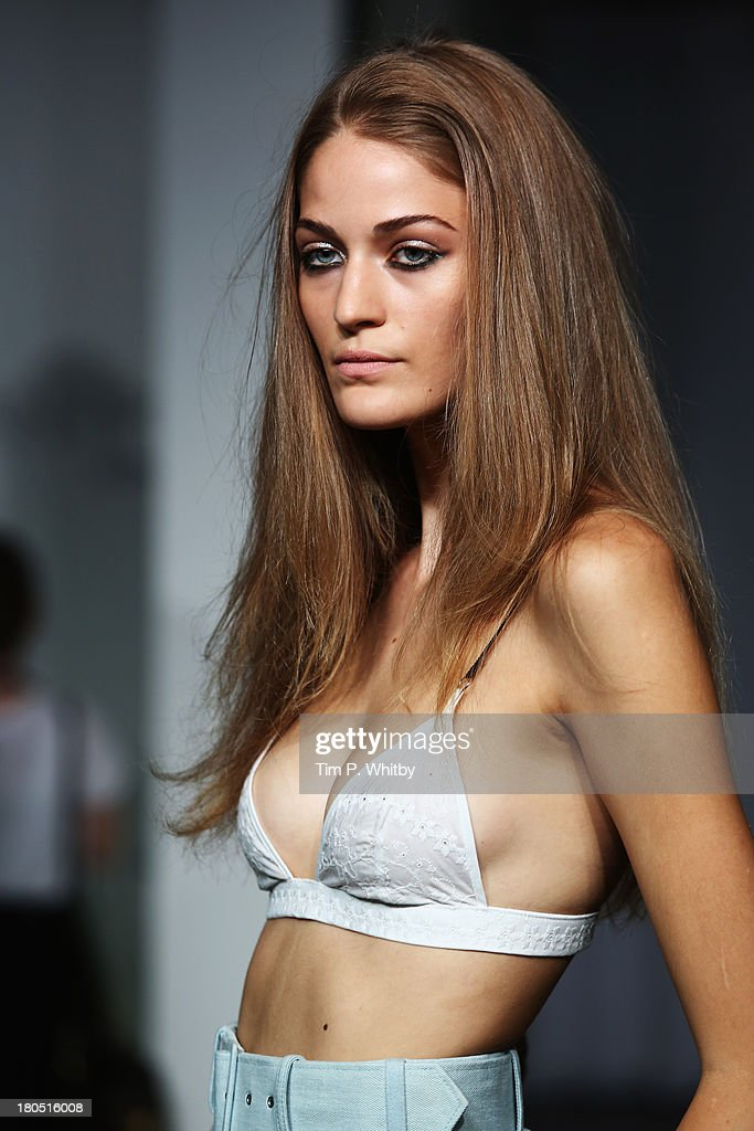 A model walks the runway during the Antipodium presentation at London Fashion Week SS14 at The Studio, Somerset House on September 14, 2013 in London, England.