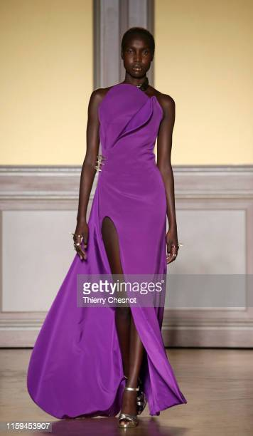 Model walks the runway during the Antonio Grimaldi Haute Couture Fall/Winter 2019 2020 show as part of Paris Fashion Week on July 01, 2019 in Paris,...
