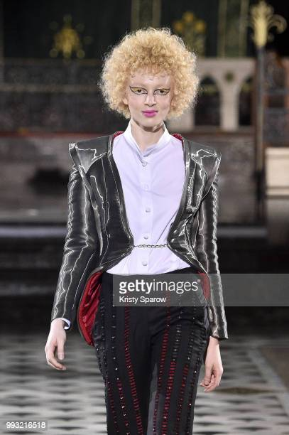 A model walks the runway during the Antonio Ortega Haute Couture Fall Winter 2018/2019 show as part of Paris Fashion Week on July 4 2018 in Paris...