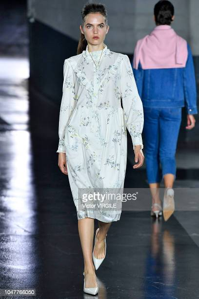 Model walks the runway during the A.P.C Ready to Wear fashion show as part of the Paris Fashion Week Womenswear Spring/Summer 2019 on October 1, 2018...
