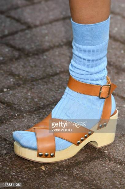 Model walks the runway during the A.P.C Ready to Wear Spring/Summer 2020 fashion show as part of Paris Fashion Week on September 30, 2019 in Paris,...