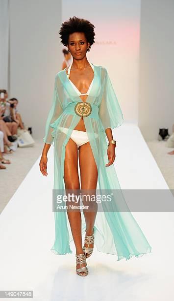 Model walks the runway during the Aqua Di Lara fashion show at Raleigh Hotel on July 21, 2012 in Miami Beach, Florida.