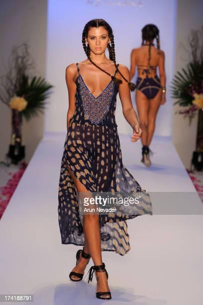 A model walks the runway during the Aqua Di Lara fashion show at MercedesBenz Fashion Week Swim 2014 at Raleigh Hotel on July 20 2013 in Miami Beach...