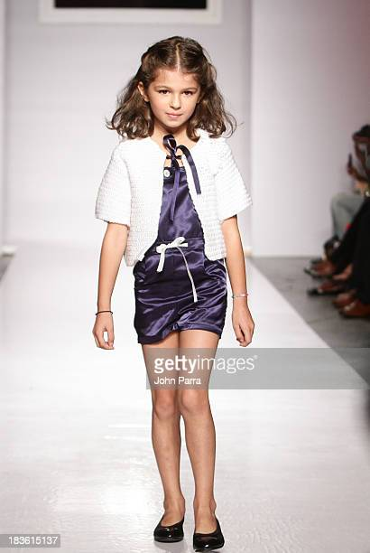 A model walks the runway during the Aracely Santamaria preview at the Parsons The School For Design at petiteParade NY Kids Fashion Week in...