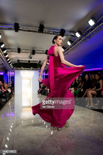 A model walks the runway during the Ariella Couture fashion show at 250 Bishopsgate on April 17 2012 in London England