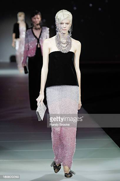 Model walks the runway during the Armani - One Night Only New York at SuperPier on October 24, 2013 in New York City.