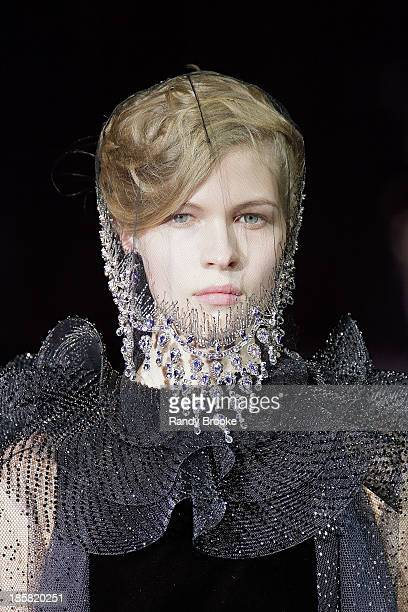 A model walks the runway during the Armani One Night Only New York>> at SuperPier on October 24 2013 in New York City