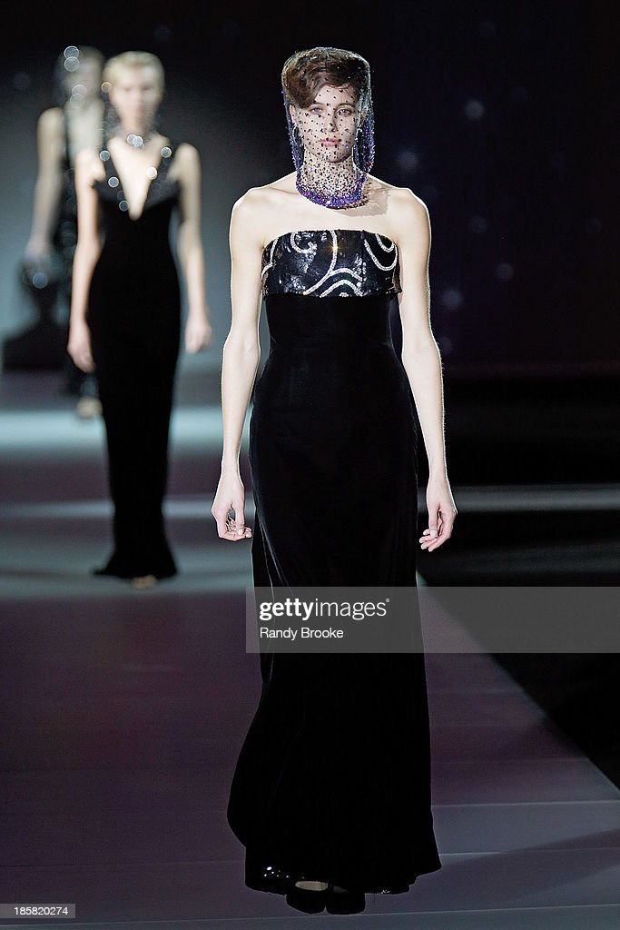 A model walks the runway during the Armani - One Night Only New York>> at SuperPier on October 24, 2013 in New York City.