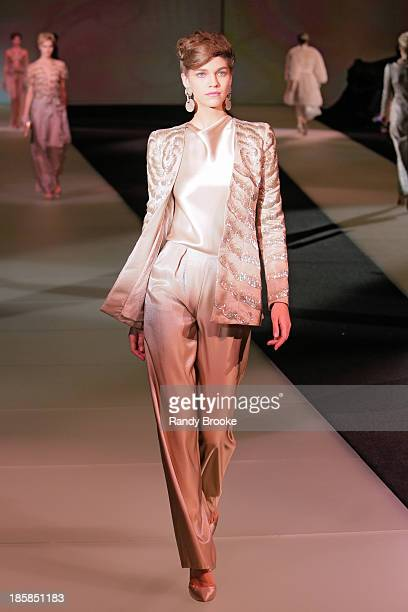 A model walks the runway during the Armani One Night Only New York at SuperPier on October 24 2013 in New York City