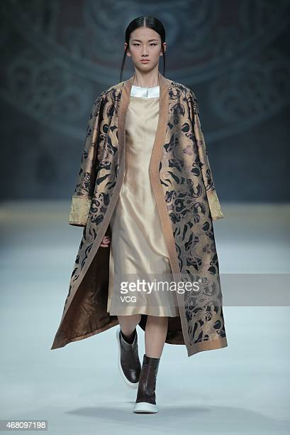 A model walks the runway during the Asahi Kasei Chinese Fashion Designer Creativity Award Zeng Fengfei Collection as part of MercedesBenz China...