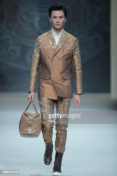 Model walks the runway during the Asahi Kasei Chinese Fashion Designer Creativity Award - Zeng Fengfei Collection as part of Mercedes-Benz China...