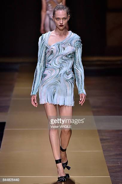 A model walks the runway during the Atelier Versace Haute Couture Fall/Winter 20162017 show as part of Paris Fashion Week on July 3 2016 in Paris...