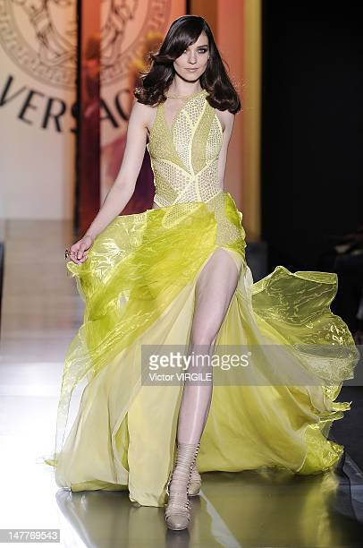 Model walks the runway during the Atelier Versace Haute Couture Fall Winter 2012-2013 show as part of the Paris Haute couture Week on July 01, 2012...