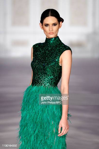 A model walks the runway during the Atelier Zuhra show mansion soirèe event during London Fashion Week February 2019 at the on February 16 2019 in...