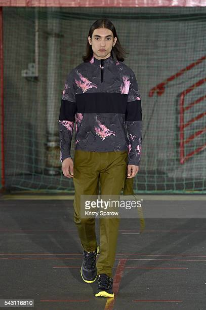 A model walks the runway during the Avoc Menswear Spring/Summer 2017 show as part of Paris Fashion Week on June 25 2016 in Paris France