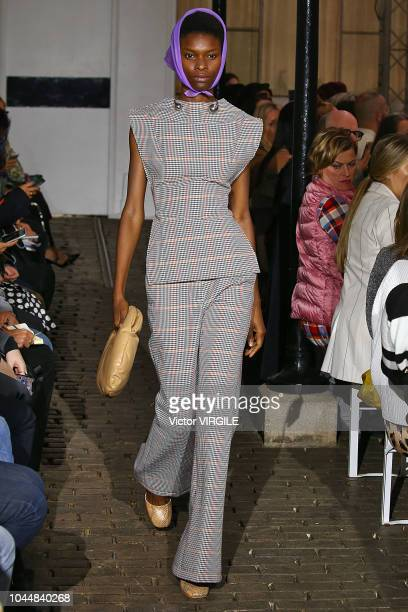 Model walks the runway during the A.W.A.K.E Ready to Wear fashion show as part of the Paris Fashion Week Womenswear Spring/Summer 2019 on September...