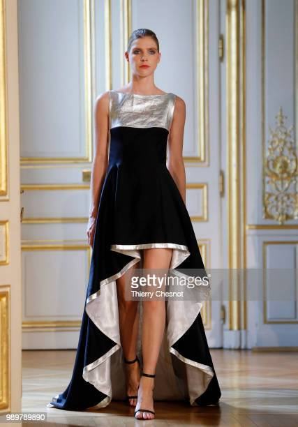 A model walks the runway during the Azulant Akora Haute Couture Fall Winter 2018/2019 show as part of Paris Fashion Week on July 2 2018 in Paris...