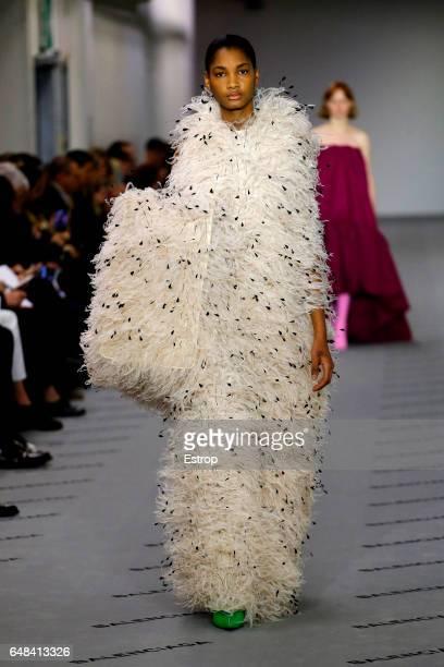 Model walks the runway during the Balenciaga designed by Demma Gvasalia show as part of the Paris Fashion Week Womenswear Fall/Winter 2017/2018 on...