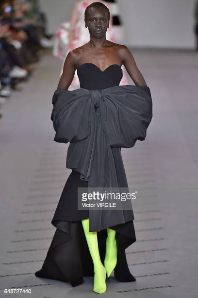 A model walks the runway during the Balenciaga Ready to Wear fashion show as part of the Paris Fashion Week Womenswear Fall/Winter 2017/2018 on March...