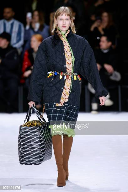 A model walks the runway during the Balenciaga show as part of the Paris Fashion Week Womenswear Fall/Winter 2018/2019 on March 3 2018 in Paris France