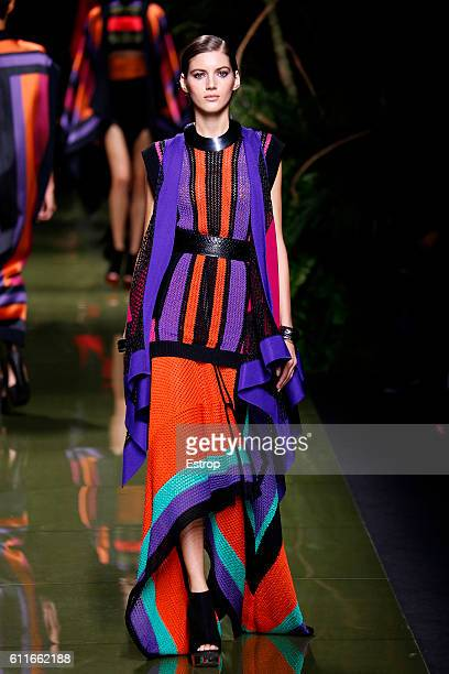 A model walks the runway during the Balmain designed by Olivier Rousteing show as part of the Paris Fashion Week Womenswear Spring/Summer 2017 on...
