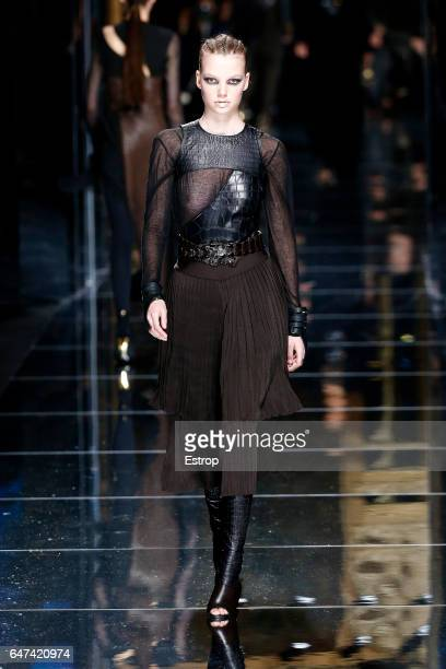 A model walks the runway during the Balmain designed by Olivier Rousteing show as part of the Paris Fashion Week Womenswear Fall/Winter 2017/2018 on...