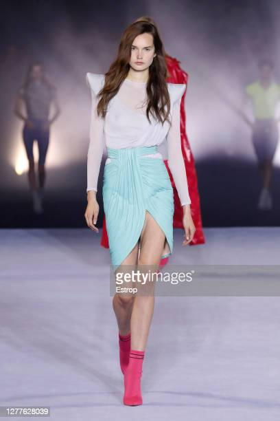 Model walks the runway during the Balmain fashion show during Paris Women's Fashion Week Spring/Summer 2021 on September 30, 2020 in Paris, France.