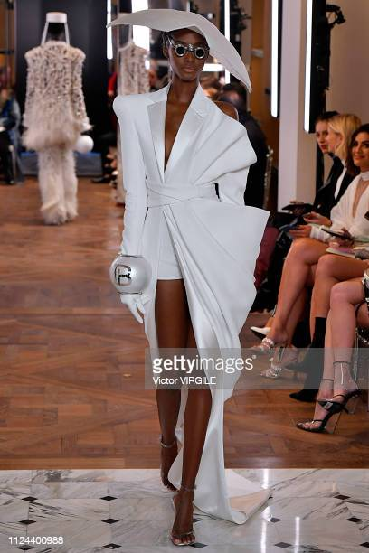 A model walks the runway during the Balmain Haute Couture Spring Summer 2019 fashion show as part of Paris Fashion Week on January 23 2019 in Paris...
