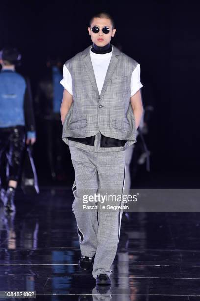 Model walks the runway during the Balmain Homme Menswear Fall/Winter 2019-2020 show as part of Paris Fashion Week on January 18, 2019 in Paris,...