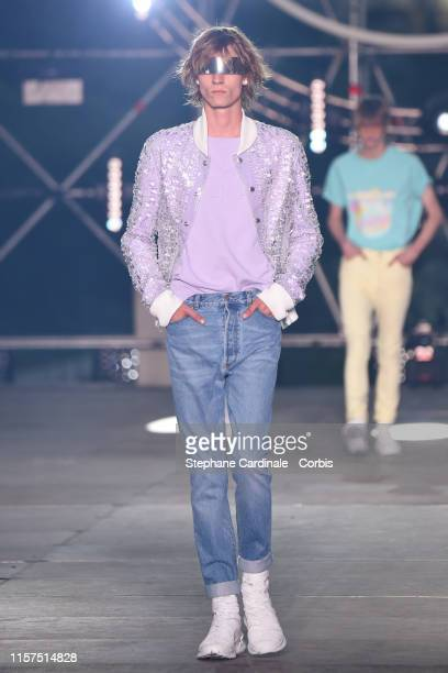 A model walks the runway during the Balmain Homme Menswear Spring Summer 2020 show as part of Paris Fashion Week on June 21 2019 in Paris France