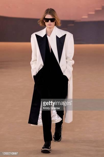 Model walks the runway during the Balmain Menswear Fall/Winter 2020-2021 show as part of Paris Fashion Week on January 17, 2020 in Paris, France.