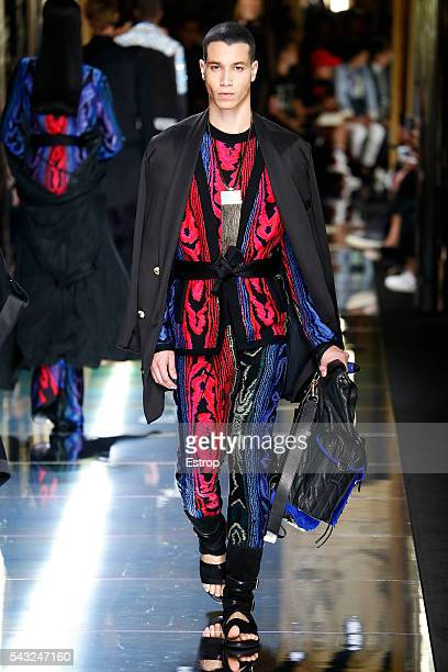 A model walks the runway during the Balmain Menswear Spring/Summer 2017 show designed by Olivier Rousteing as part of Paris Fashion Week on June 25...