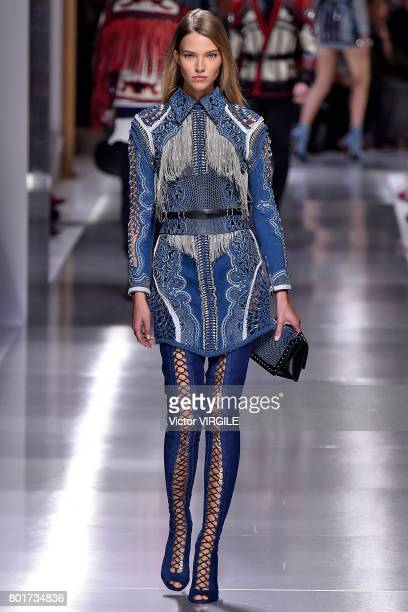 A model walks the runway during the Balmain Menswear Spring/Summer 2018 show as part of Paris Fashion Week on June 24 2017 in Paris France