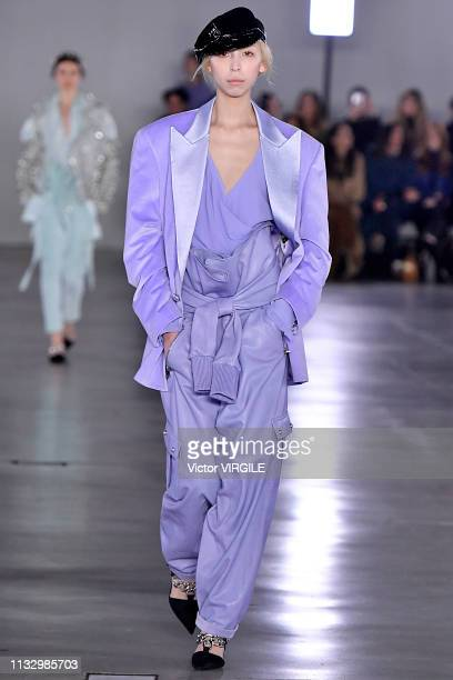 A model walks the runway during the Balmain Ready to Wear fashion show as part of the Paris Fashion Week Womenswear Fall/Winter 2019/2020 on March 01...
