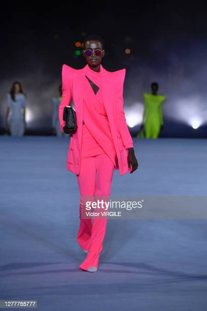 Model walks the runway during the Balmain Ready to Wear Spring/Summer 2021 fashion show as part of Paris Fashion Week on September 30, 2020 in Paris,...