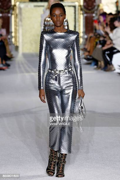 A model walks the runway during the Balmain Ready to Wear Spring/Summer 2018 fashion show as part of the Paris Fashion Week Womenswear Spring/Summer...