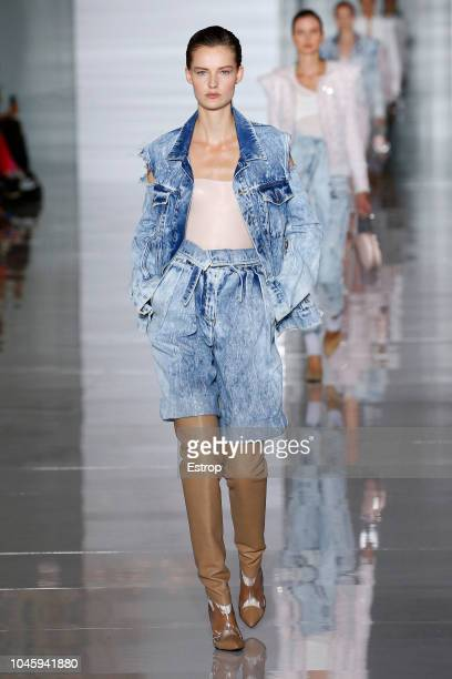 A model walks the runway during the Balmain show as part of the Paris Fashion Week Womenswear Spring/Summer 2019 on September 28 2018 in Paris France