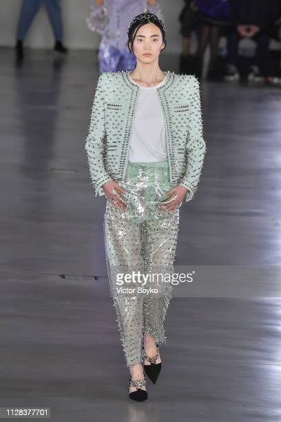 A model walks the runway during the Balmain show as part of the Paris Fashion Week Womenswear Fall/Winter 2019/2020 on March 1 2019 in Paris France