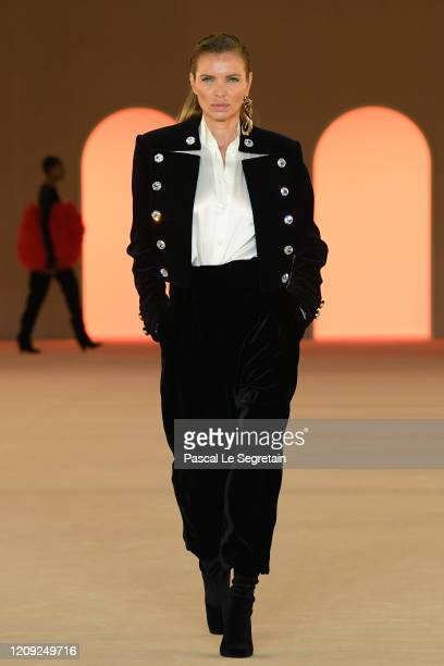 A model walks the runway during the Balmain show as part of the Paris Fashion Week Womenswear Fall/Winter 2020/2021 on February 28 2020 in Paris...
