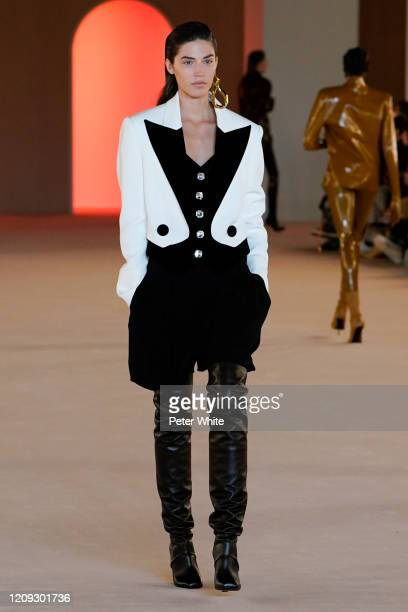 Model walks the runway during the Balmain show as part of the Paris Fashion Week Womenswear Fall/Winter 2020/2021 on February 28, 2020 in Paris,...