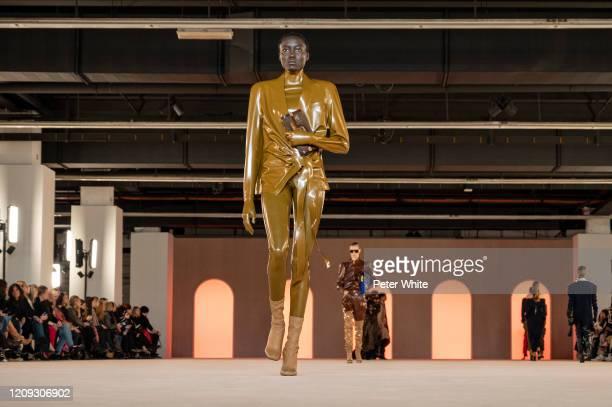 A model walks the runway during the Balmain show as part of the Paris Fashion Week Womenswear Fall/Winter 2020/2021 on February 28 2020 in Paris...