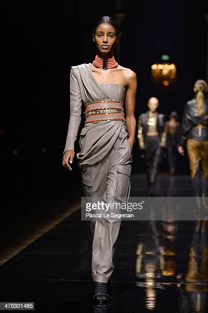 A model walks the runway during the Balmain show as part of the Paris Fashion Week Womenswear Fall/Winter 20142015 on February 27 2014 in Paris France
