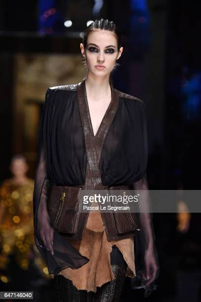 A model walks the runway during the Balmain show as part of the Paris Fashion Week Womenswear Fall/Winter 2017/2018 on March 2 2017 in Paris France