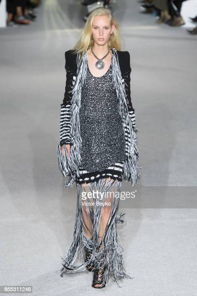 A model walks the runway during the Balmain show as part of the Paris Fashion Week Womenswear Spring/Summer 2018 on September 28 2017 in Paris France