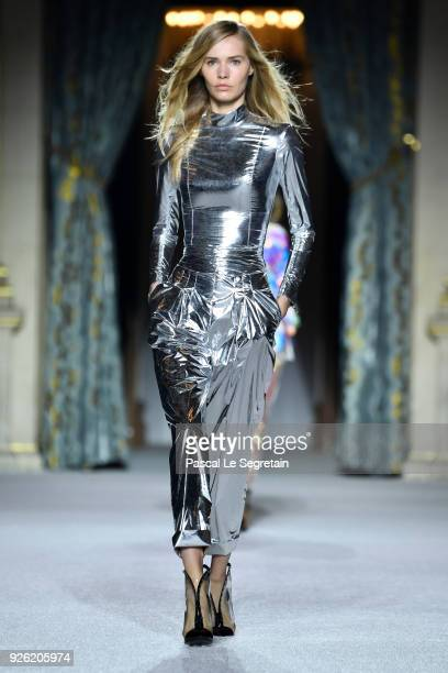 A model walks the runway during the Balmain show as part of the Paris Fashion Week Womenswear Fall/Winter 2018/2019 on March 2 2018 in Paris France