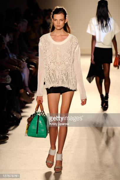 A model walks the runway during the Barbara Bui Ready to Wear Spring / Summer 2012 show during Paris Fashion Week at Hotel Ritz on September 29 2011...
